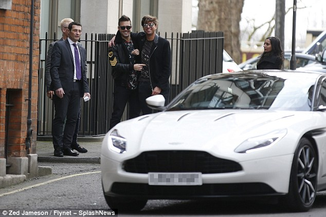Check it out! Spencer looked eager to get into his new car as it was parked up in the capital