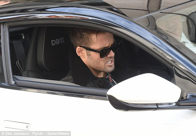 Rev it up: The reality TV star was also spotted testing out the speed as he jumped in the drivers seat after picking up the keys