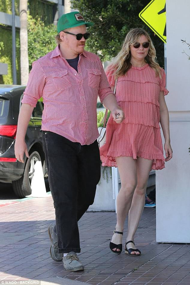 What a pair! The actress covered her growing baby bump in a springtime chic pink dress that matched the color of her fiance JessePlemons' plaid shirt