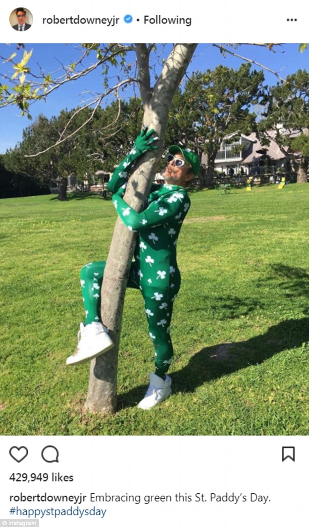 Kooky:Downey also had some fun on the annual holiday. The Iron Man actor wore a green bodysuit with white three leaf clovers all over it as he hugged a tree in a massive back yard