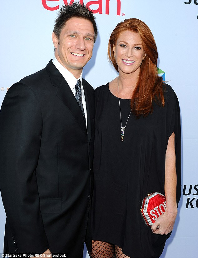 Moving on: Angie Everhart filed documents to end her marriage to Carl Ferro according to a Wednesday report from TMZ. They wed in 2014 and are pictured together back in October