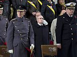 FILE - In this Monday, Nov. 11, 2013 file photo, Belgium's Prince Laurent, front right, and Britain's Prince Philip, front left, participate in a special Armistice Day ceremony under the Menin Gate in Ypres, Belgium. The Belgian parliament on Friday, March 30, 2018 has withdrawn part of the endowment of the ever-controversial Prince Laurent after he showed up at a Chinese diplomatic function in military uniform without the consent of the government. (AP Photo/Virginia Mayo, File)