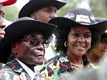 Hundreds of villagers have invaded the farm of former Zimbabwean dictator Robert Mugabe's wife Grace (pictured) to dig for gold, hurling abuse and destroying her fruit trees