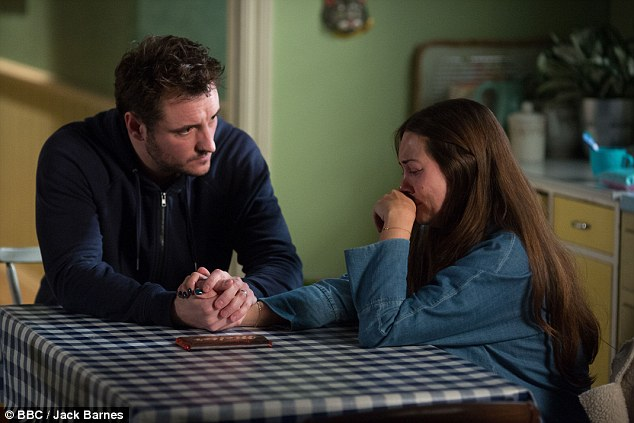 Struggling: Stacey and Martin share the moment after she lashes out at him in her grief around Kat's death, but after apologising the estranged couple share their romantic moment