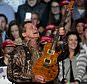 """FILE - In this Nov. 7, 2016 file photo, musician Ted Nugent performs before Republican presidential candidate Donald Trump comes on stage for his campaign rally before the general election, in the Grand Gallery at DeVos Place in Grand Rapids, Mich.   Nugent says the Florida students calling for gun control have """"no soul"""" and are """"mushy brained children."""" He made the comments Friday while defending the National Rifle Association as a guest on the Joe Pags Show, a nationally syndicated conservative radio program. Nugent, an NRA board member, said survivors of the Parkland school shooting are wrong to blame the NRA for mass shootings.(Joel Bissell/The Grand Rapids Press via AP, File)"""