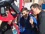 Kyle Kashuv (seen second from left with conservative activist Charlie Kirk arguing with demonstrators in Washington on Saturday), a survivor of the Parkland high school massacre last month, has emerged as a pro-gun voice opposed to his schoolmates' movement
