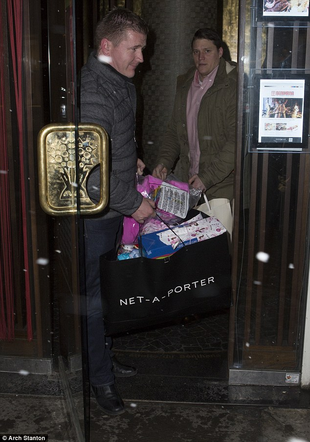 Wow: The huge bag of presents required the assistance of two men