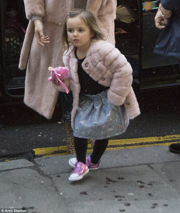Cute: Sophia looked absolutely adorable in her matching pink coat and bright shoes as she prepared for her big day