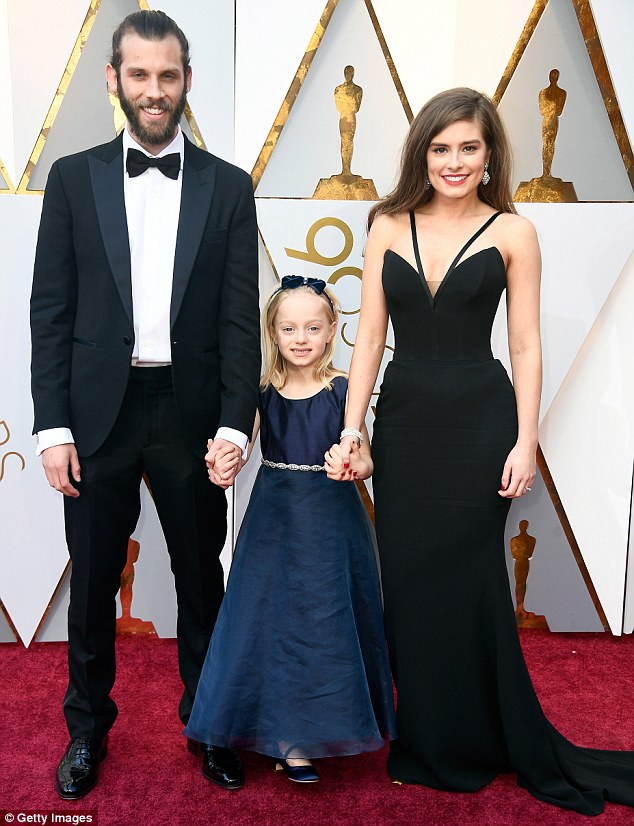 Star of The Silent Child Rachel Shenton (right) and her fiance Chris Overton (left), who directed the film, have barely had a second to fully savour the fact they have won an Oscar. The couple are pictured with its star Maisie Sly, five