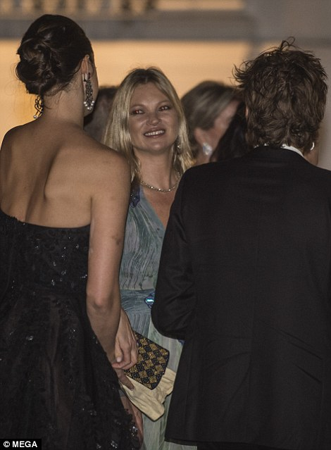 The model looked in high spirits as she attended the cocktail party