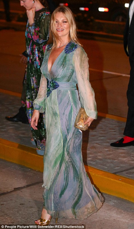 The supermodel looked in very high spirits as she arrived at the glitzy bash