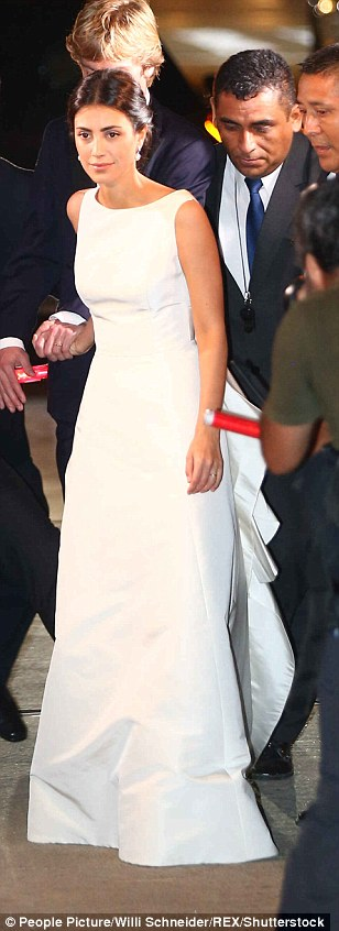 Alessandra looked stunning in an elegant white gown