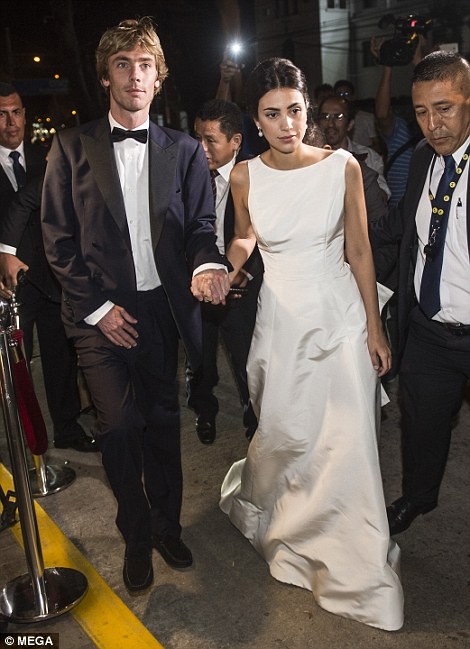 The glamorous newlyweds arrived at the venue hand-in-hand