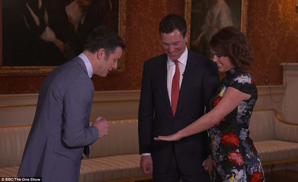 Princess Eugenie gives BBC presenter Matt Baker a look at her engagement ring, as fiance Jack Brooksbank watches on