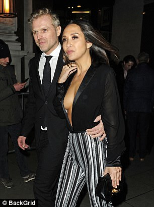 Hunk: While she toted her belongings in a chic black handbag, Myleene's best accessory proved to be her other half Simon