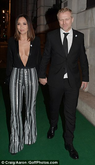 Style star: Her seventies inspired bottoms hugged onto her sensational curves and showed a peek of her towering black heels