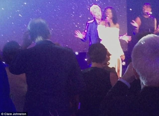 Double acts you never thought you'd see! Emma Thompson dances behind Heather Small on stage in Edinburgh after the Nanny McPhee actress collected a cheque for £500,000 for The Helen Bamber Foundation