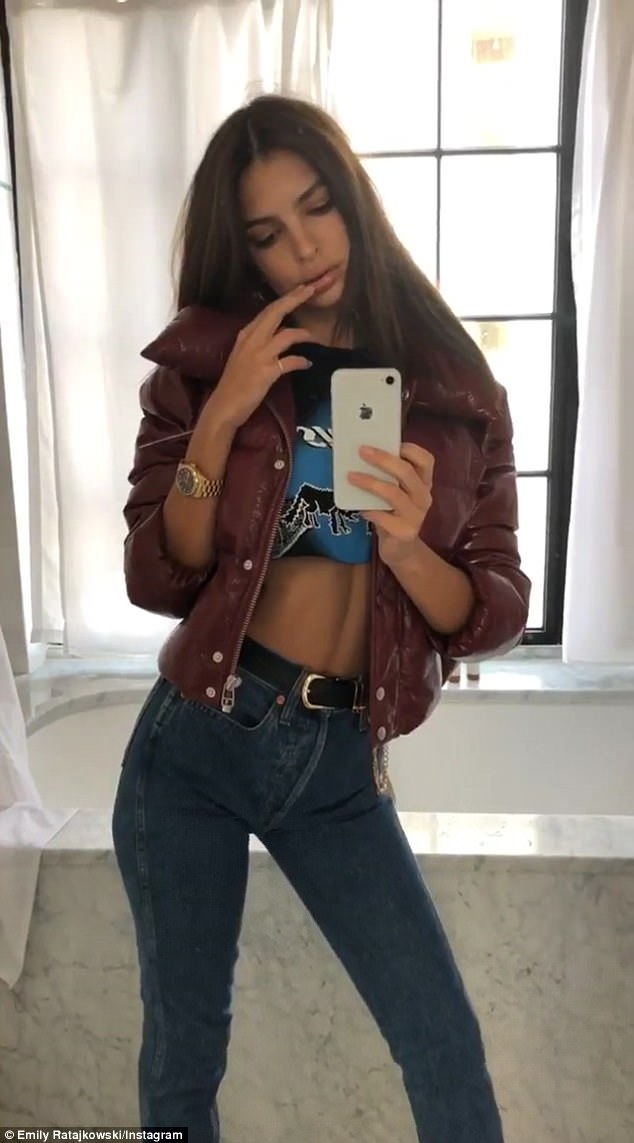 Toned and tan:Emily Ratajkowski found some down time to snap a quick boomerang selfie on her Instagram account on Wednesday