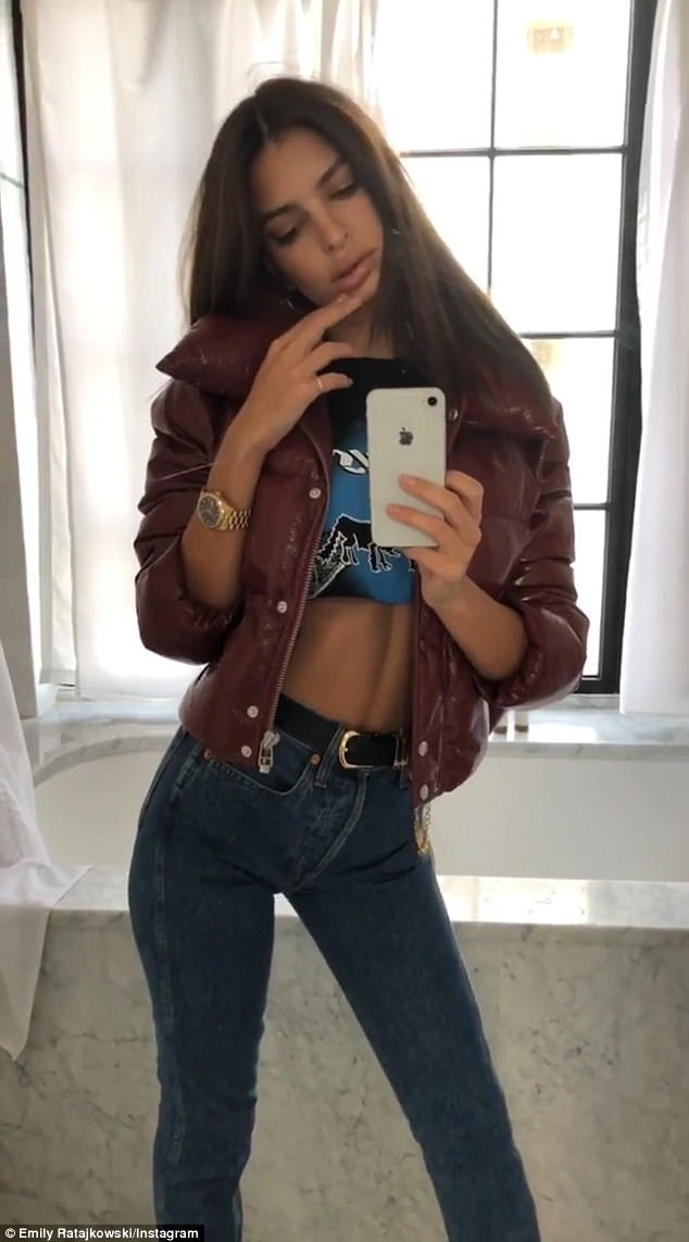 Effortless:The model turned designer, 26, showed off her impeccable physique in a black graphic cut-off crop top which gave a peek of her toned abs