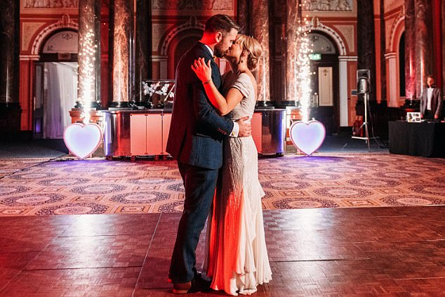The couple finally shared their first kiss on the dancefloor during their first dance to the sound of applause from their families