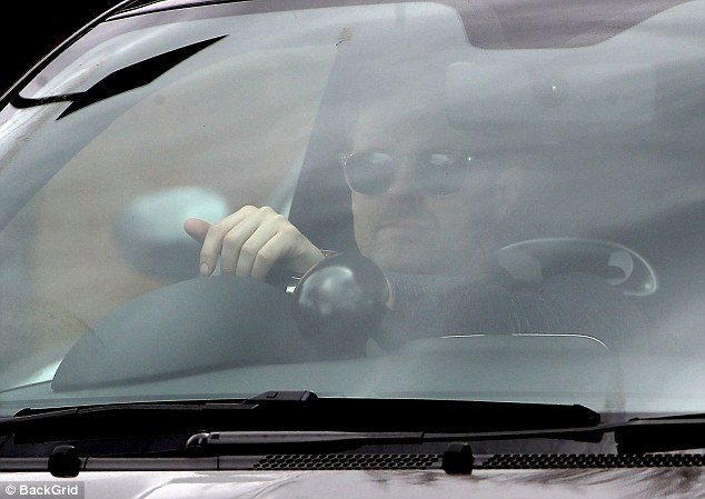 Low-profile: The star chose to shield his eyes beneath a pair of shades despite the grey weather