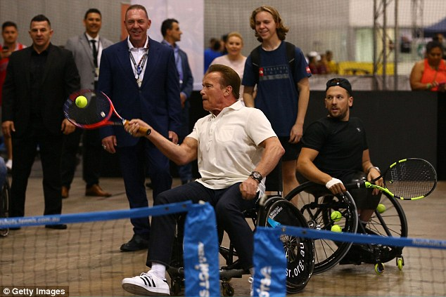 What a match! Arnold was also game to get into a wheelchair and do a friendly match with the Paralympian, and was seen wheeling himself around the mini arena