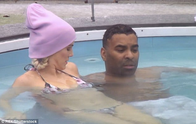 Heating up: Ashley James, 30, has upped the ante as she showcased her sensational figure while sharing a hot tub with her new squeeze Ginuwine, 47, on Monday's Celebrity Big Brother