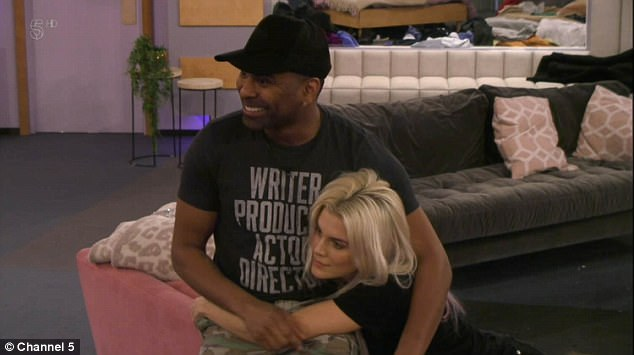 Cheeky: Ginuwine, 47, amped up the PDA with Ashley James, 30, as he gave her a steamy lower back massage during Sunday night's episode of Celebrity Big Brother