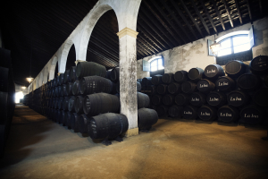 Sherry Bodega, notice the placement of open windows high above the barrel stacks that help regulate the temperature and humidity of the Bodega (photo credit www.haciendadesanrafael.com)