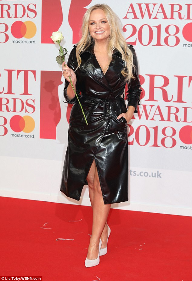 Wow-factor! The Heart FM host put her toned pins on display as the chic PVC coat fell against her legs