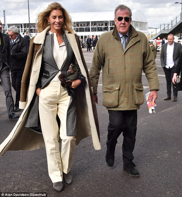 Going strong:Often on their sun-drenched getaways across the globe, the axed Top Gear presenter and his ladylove set their sights on the racecourse for the day
