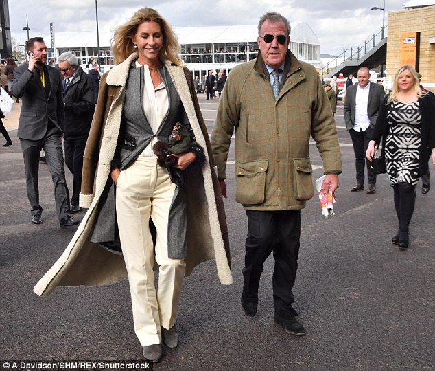 Stepping out:The outspoken television personality, 57, dressed to impress in a tweed jacket as he cuddled up to his stunning girlfriend, 46
