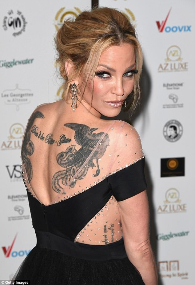Tatt's nice:With a plunging detail, Sarah's dress gave her the opportunity to show off the distinctive tattoos covering her upper back as she posed for photos