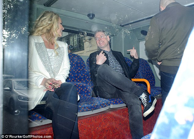 Doing the rounds: Once on the bus, Britney was joined by journalists for a series of interviews