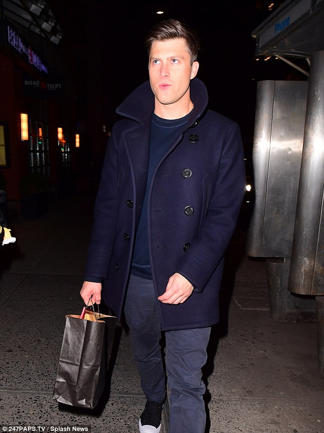 Rugged: Jost looked handsome in a black pea coat with black slacks and black-and-white sneakers