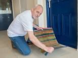 John Whelan, pictured, and his wife Alicia were handed an ASBO for trying to brighten up the communal areas of Sefton Park tower block in Liverpool with a welcome mat