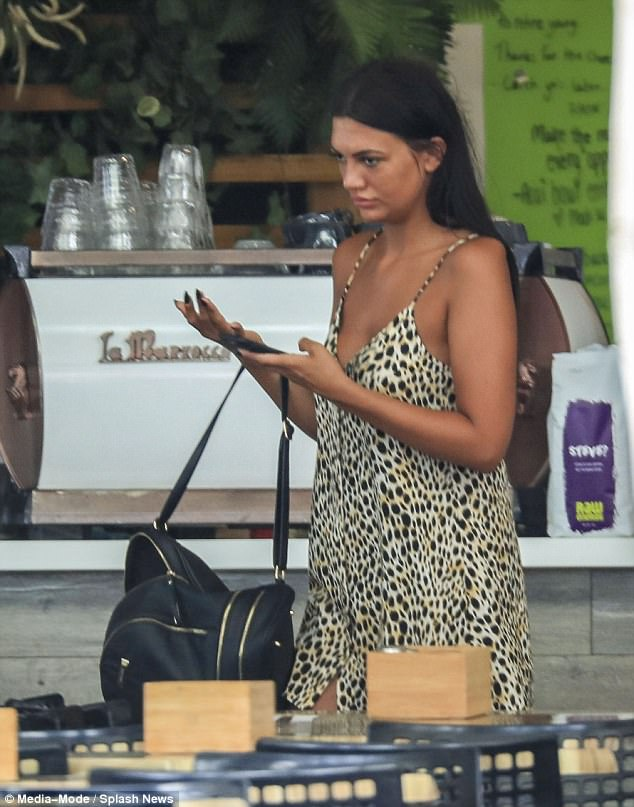 Lovely in leopard: Abbie looked stylish while showing off the glowing tan she acquired during the working trip