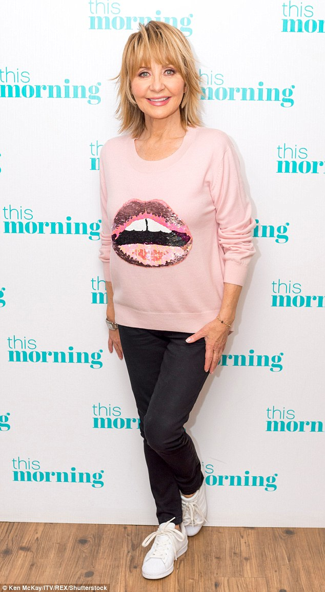 Stylish: The National Treasure looked sensational on the programme in her sequin lip detailed jumper and black denims