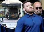 Just a day after he was released from jail for throwing a metal hand truck at a bus window, Conor McGregor (pictured leaving court on Friday) was reportedly 'being rowdy' in an upscale Manhattan hotel