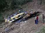 A ten-year-old boy has revealed his miracle escape from a horrifying school bus crash in India which left 23 children dead. Pictured: The mangled wreckage of the vehicle near Nurpur in Kangra District
