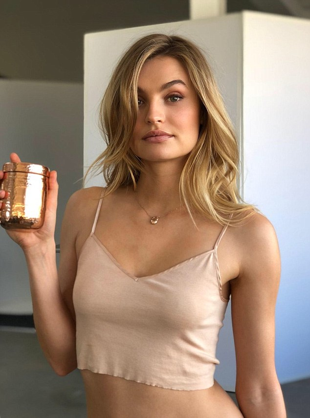 Enhancing her beauty: Victoria's Secret Angel Roosmarijn de Kok with LYMA's copper case