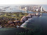 The wealthiest zip code in the United States, where the average income in 2015 was $2.5million per year, is Fisher Island (left), a barrier island located just a short boat ride away from Miami Beach (right)