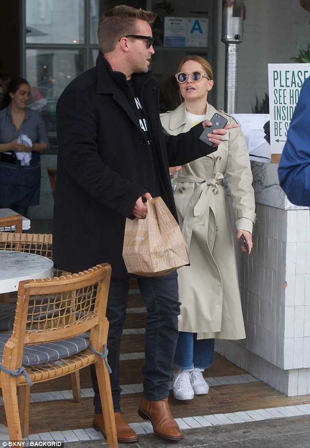 Are they or aren't they? Mena's dapper male companion paired a black T-shirt with a set of gray skinny jeans and brown boots. It is unknown if the two are simply friends, or are indeed dating