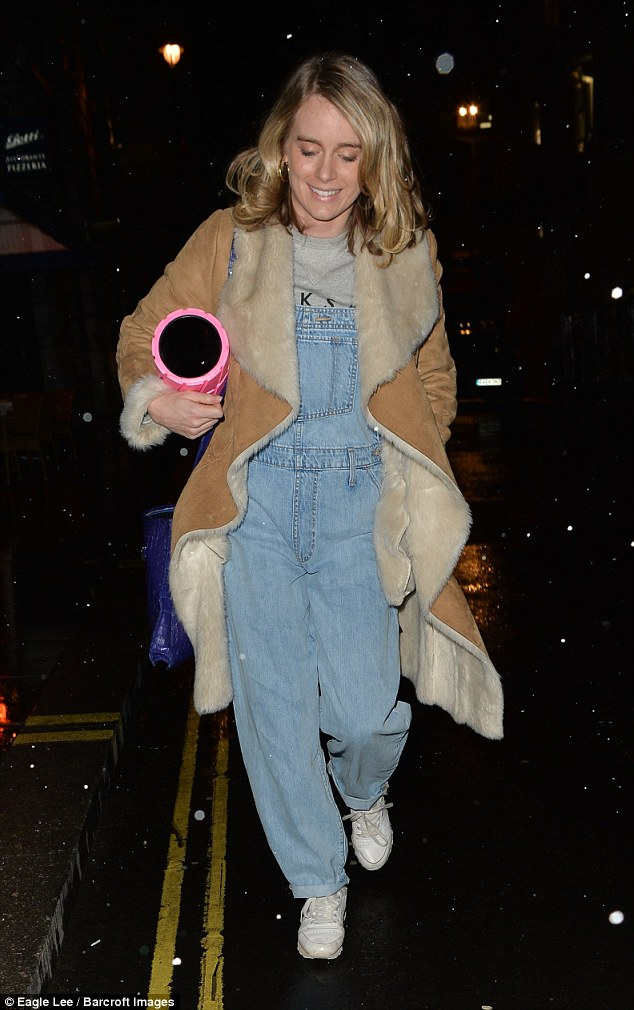 The actress, 29, completed her dressed-down look with a grey T-shirt and denim dungarees