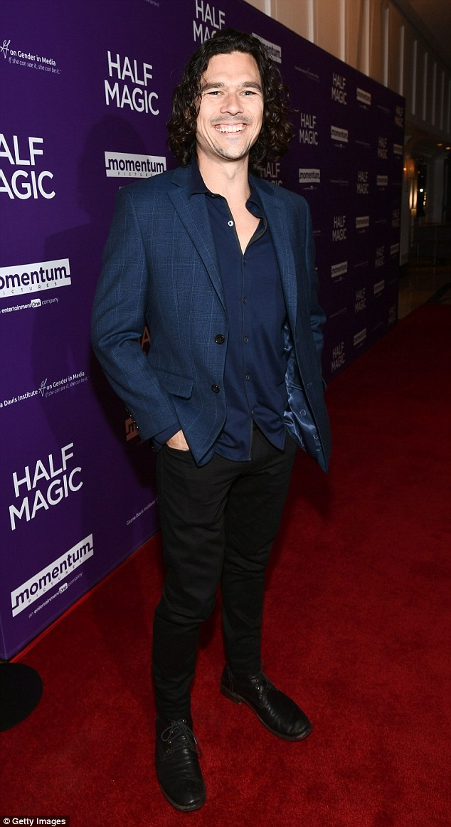 Dapper:Luke Arnold changed it up in a blue jacket and shirt with black pants for the soiree