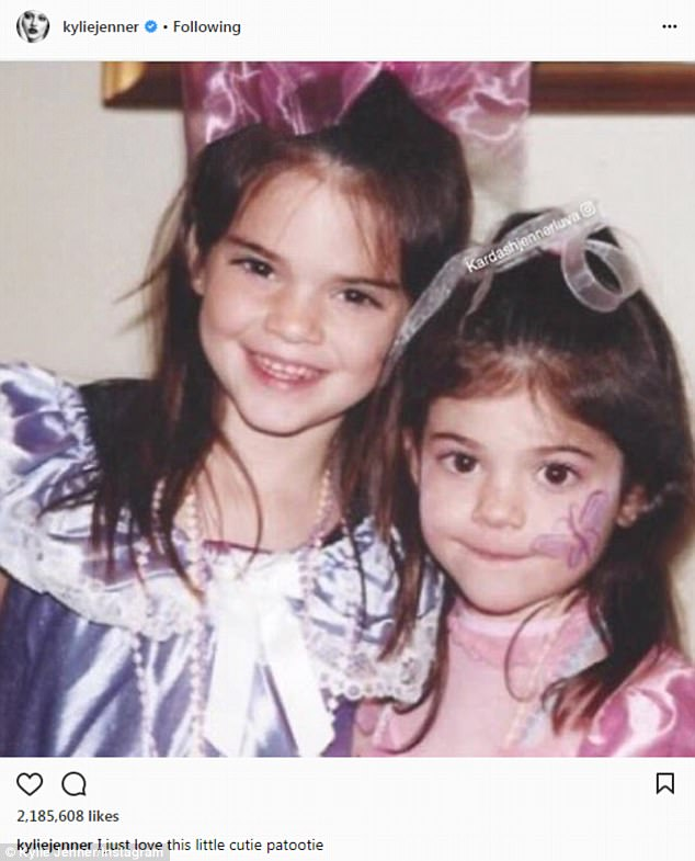 With face paint: Kylie, right, with sister Kendall when she was about four years old