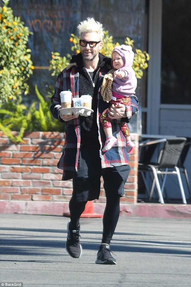 Daddy duty: Adam was spotted taking Dusty on a coffee run on Tuesday