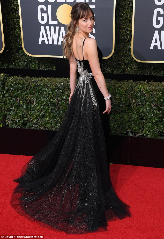 Glam girl: The 50 Shades Of Grey actress looked much more glamorous when she attended the 75th Annual Golden Globe Awards in Los Angeles during January