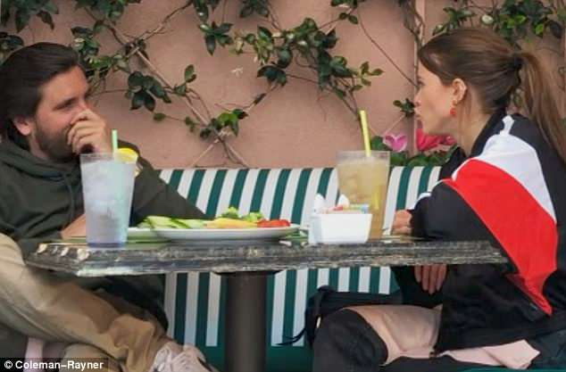 Going strong: The pair, who have been dating for nearly one year, ate at the hotel's poolside Cabana Cafe
