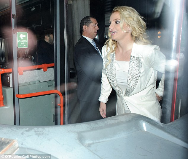 Channelling her inner tourist: Britney Spears was seen getting on a double decker tourist bus in London on Tuesday to do some interviews about her upcoming album